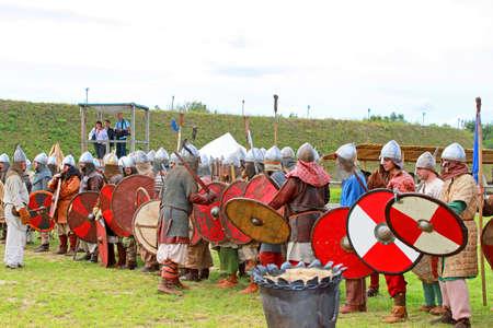Warriors at historic reconstruction of Kievan Rus in the ethnopark Kievan Rus in the village Kopachiv, near Kyiv, Ukraine Editorial