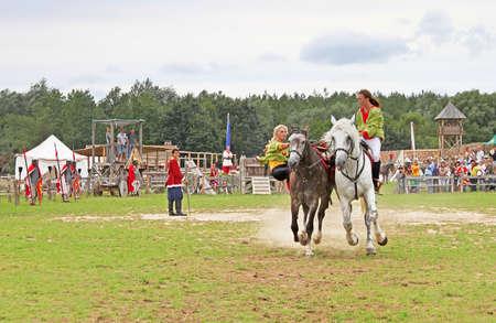 Horsewoman at historic reconstruction of Kievan Rus in the ethnopark Kievan Rus in the village Kopachiv, near Kyiv, Ukraine Editorial