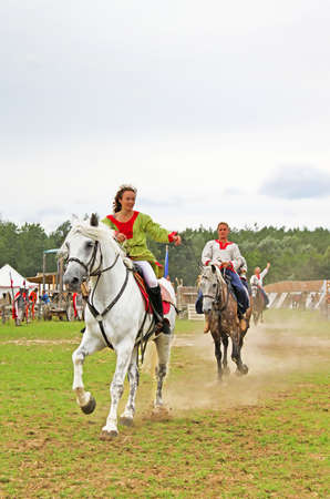 Riders at historic reconstruction of Kievan Rus in the ethnopark Kievan Rus in the village Kopachiv, near Kyiv, Ukraine
