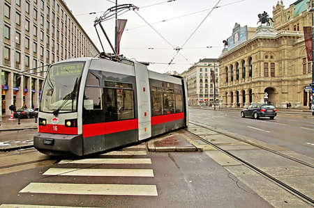 Public transportation with tram near Vienna State Opera at the city center of Austrias capital city Vienna.