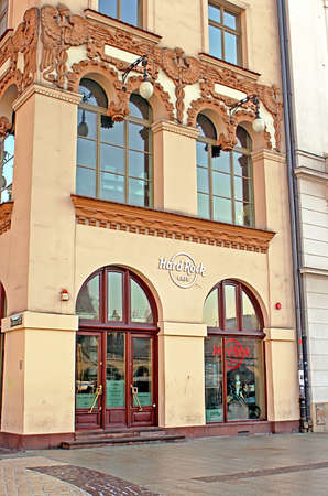Hard Rock Cafe in Krakow is located in the UNESCO World Heritage Market Square, next door to the most famous church in Poland, St. Marys Basilica. Cafe has room for 130 guests over three spacious floors Editorial