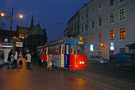 Old tram in Krakow at night, Poland. The tramway has been in operation since 1882. There are 22 ordinary, 2 fast, and 3 night, tramlines with a total linelength of 347 kilometres Editorial