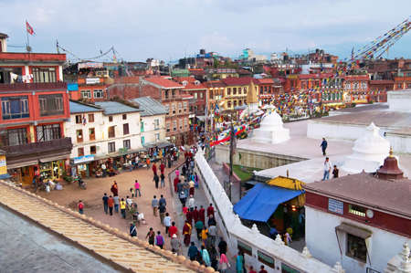 People circles around the Boudhanath stupa in Kathmandu, Nepal. The Boudhanath stupa is the holiest Buddhist landmark in Nepal and UNESCO site since 1979