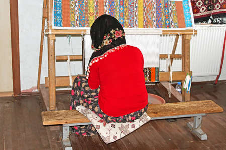 weavers: Local woman weaves a carpet by hand in Antalya, Turkey. This low-tech method has remained unchanged for centuries