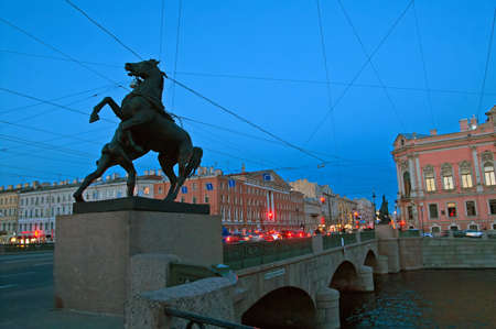 Anichkov Bridge with sculptures of horses, Saint-Petersburg, Russia. The Anichkov Bridge, is the oldest and most famous bridge across the Fontanka River in Saint Petersburg, Russia. The current bridge, built in 1841-42 and reconstructed in 1906-08, combin