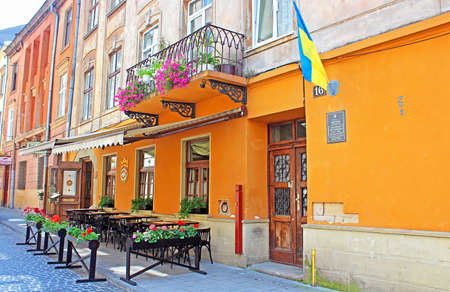 Typical street cafe near the historic stone house of Bohushivska. Due to comprehensive cultural programme, and tourism infrastructure (now Lviv has more than 8,000 hotel rooms, over 700 cafes and restaurants, free WI-Fi zones in the city centre, and good  Editorial