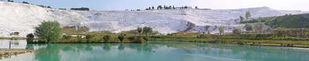 Panorama of lake and calcified limestone terraces, Pamukkale, Turkey