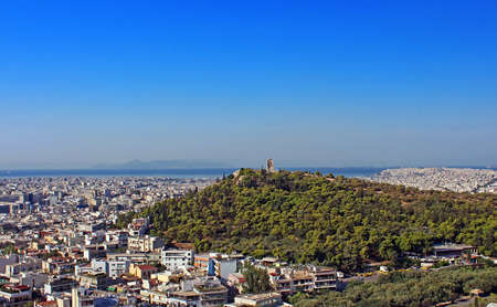 Philopappus hill and monument at Athens, Greece Imagens