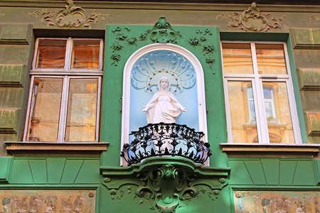 Statue of Saint Mary on the building, located on Drukarska Street 2, Lviv, Ukraine Editorial