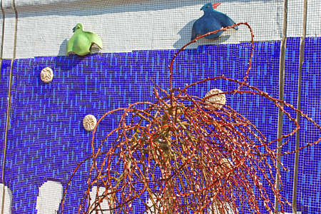 constantin: Sculptured panel of colorful crows by the sculptor Constantin Skretutsky at Pejzazhna alley, the famous childrens park in Kyiv, Ukraine Editorial
