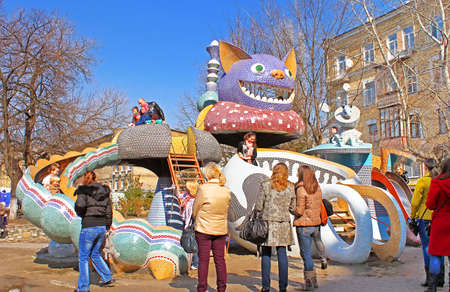 Unidentified people on childrens Alice in Wonderland playground in Picturesque Alley by sculptor Konstantin Skretutskiy Editorial
