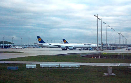 ag: The Flughafen Munich Airport (MUC), the second busiest airport in Germany, is a hub for Germain airline Lufthansa (LH). Deep blue filter