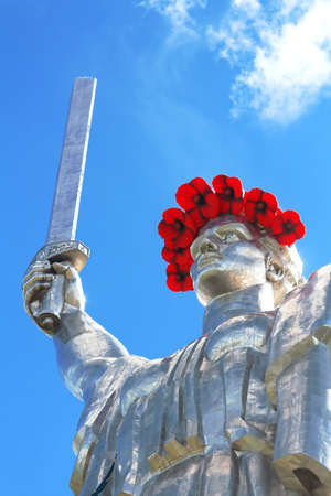 The monument Mother Motherland decorated with a wreath of poppies on the Day of Remembrance and Reconciliation in Kyiv, Ukraine Editorial