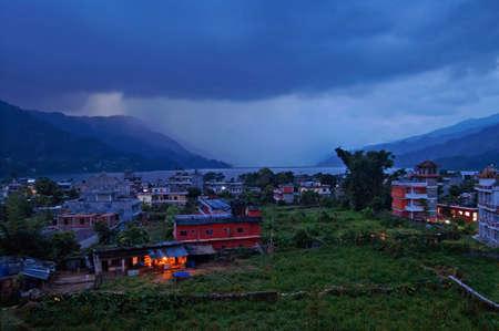 phewa: Pokhara and Lake Phewa in Nepal in the evening Stock Photo