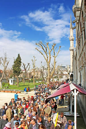 Unidentified people stand in line in Blue mosque