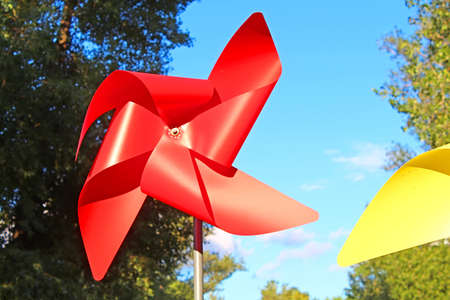 Large red and yellow children pinwheels in the Natalka park, Kyiv, Ukraine