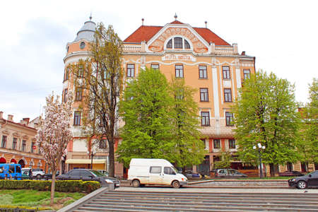 Former Hotel Bristol from the Philharmonic square, where tourists and locals like to feed the pigeons, Chernivtsi, Ukraine