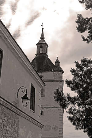 Bell Tower of the Armenian church in Kamianets-Podilskyi, Western Ukraine. Black and white filter