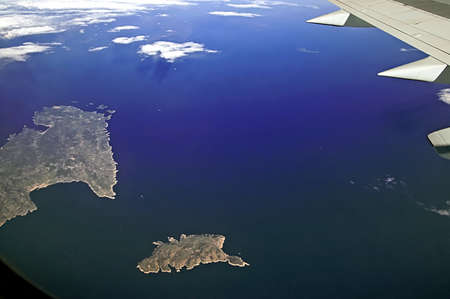 Islands in the Mediterranean Sea near the coast of Italy, view from the plane