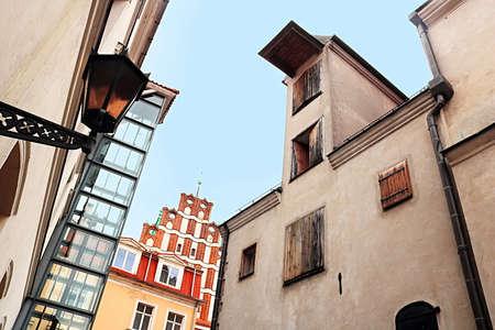 View of Saint John's Church (red bulding) andold industrial building (left), Riga, Latvia