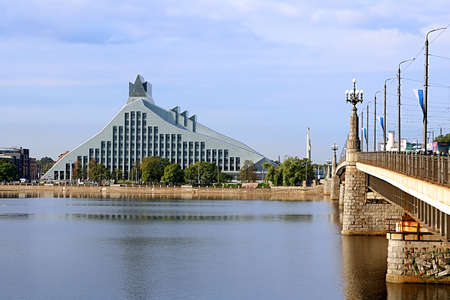 Modern building of the National Library of Latvia and Stone bridge. The National Library of Latvia, also known as Gaismas Pils (Castle of Light), is a national cultural institution under the supervision of the Latvian Ministry of Culture. The National Lib
