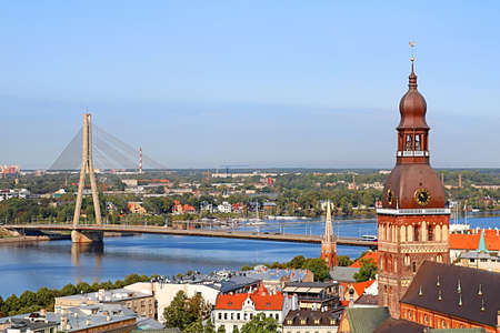 Cityscape aerial view on the old town with Dome cathedral and Vansu bridge through Daugava river in Riga city, Latvia Editorial
