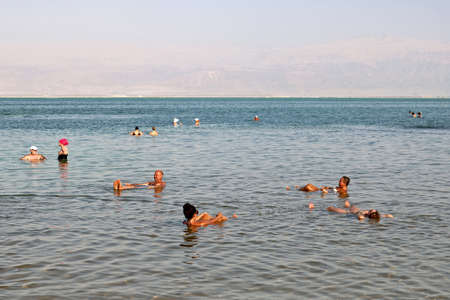 Vacationers and tourists bathe in the Dead Sea in Ein Bokek, Dead Sea, Israel
