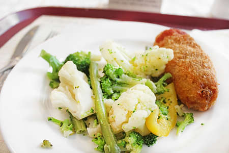 Lunch of the Kyiv cutlet, broccoli, cauliflower and asparagus on the white plate Stockfoto