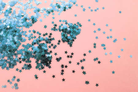 Delicate pink background with blue glitter stars. Flat lay. Holiday concept. New year time 版權商用圖片