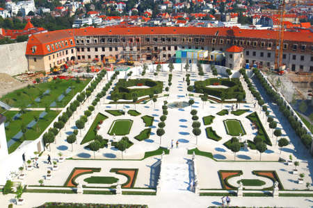 BRATISLAVA, SLOVAKIA - SEPTEMBER 01 2019: Unidentified tourists in Baroque Garden. Top view af garden and fortification building. Elevation point from Bratislava castle