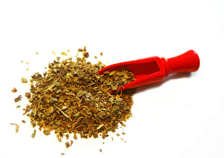 Red wooden scoop with oregano on white background Reklamní fotografie