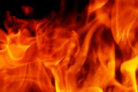 Fire in the dark, close up. Can be used as background
