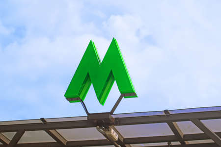 KYIV, UKRAINE - JULY 04, 2020: Green metro sign and blue sky as background Editorial