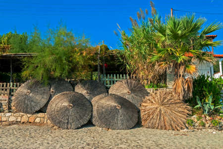reed umbrella on comfortable cozy resort in greece halkidiki