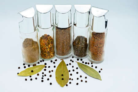 set of spices for cooking in glass bottles Banque d'images