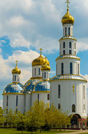 cupolas: Church with golden cupolas in the city of Brest in early spring. Stock Photo