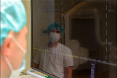testimony: Anesthesiologists in the operating room before surgery study on the testimony monitor the patients condition.