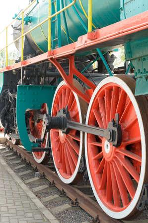 loco: Wheel detail of a vintage steam train locomotive