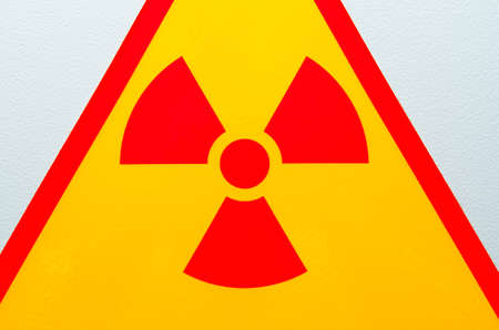 Bright warning sign of radiation safety talking about the dangers Stock Photo