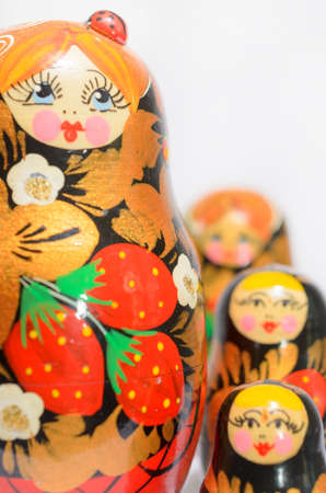 Russian matryoshkas on a light background and a colored background. Stock Photo