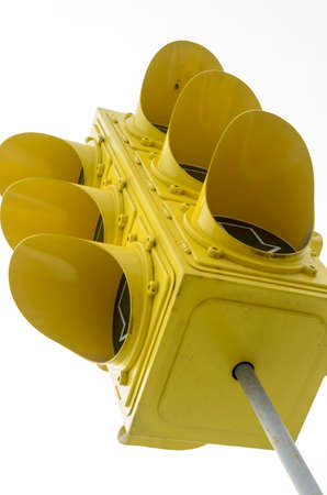 A huge yellow traffic light isolated against a light background