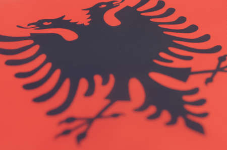 Abstract image of a fragment of the flag of Albania Stock Photo