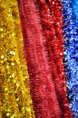 New Years fluffy tinsel of foil red blue yellow flowers.
