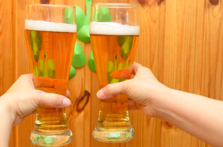 Glasses with golden beer for St. Patricks Day