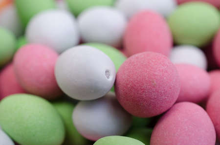 Background of a pastel green, white and pink color close-up.