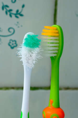 Two toothbrushes look at each other in the bathroom Reklamní fotografie