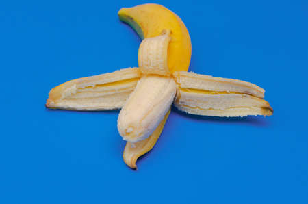 Ripe banana on blue background. The concept of healthy eating. The concept of summer