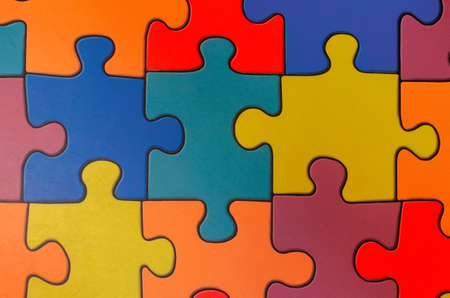 Fragment of a floor in a childrens game room from multi-colored puzzles.
