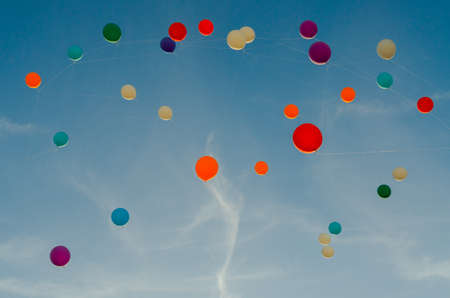 A lot of multi-colored balloons in the sky Stock fotó
