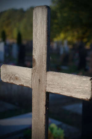 Gloomy crosses on the graves of a cemetery. Halloween. Stock Photo